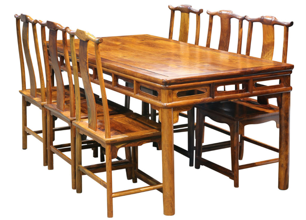 This huanghuali dining table and six side chairs sold for well past the high estimate for $145,000. Clars Auction Gallery image