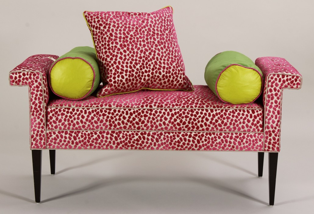 Cerise and ivory low bench with matching pillow and lime-green bolsters, est. $600-$900