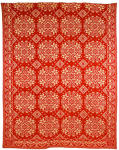 Red and white jacquard coverlet, boasting a detailed eagle image border, circa 1836, sold for $2,430 in 2011. Photo courtesy Pook & Pook Inc.