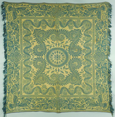 "Tennessee teal and white jacquard coverlet, Maryville Woolen Mill Co., late 19th century. Corners are inscribed ""M.W.M. Tenn.' It sold for $1,428 (with buyer's premium) during a 2012 auction at Case Antiques Auctions & Appraisals. Photo courtesy Case Antiques Auctions & Appraisals"