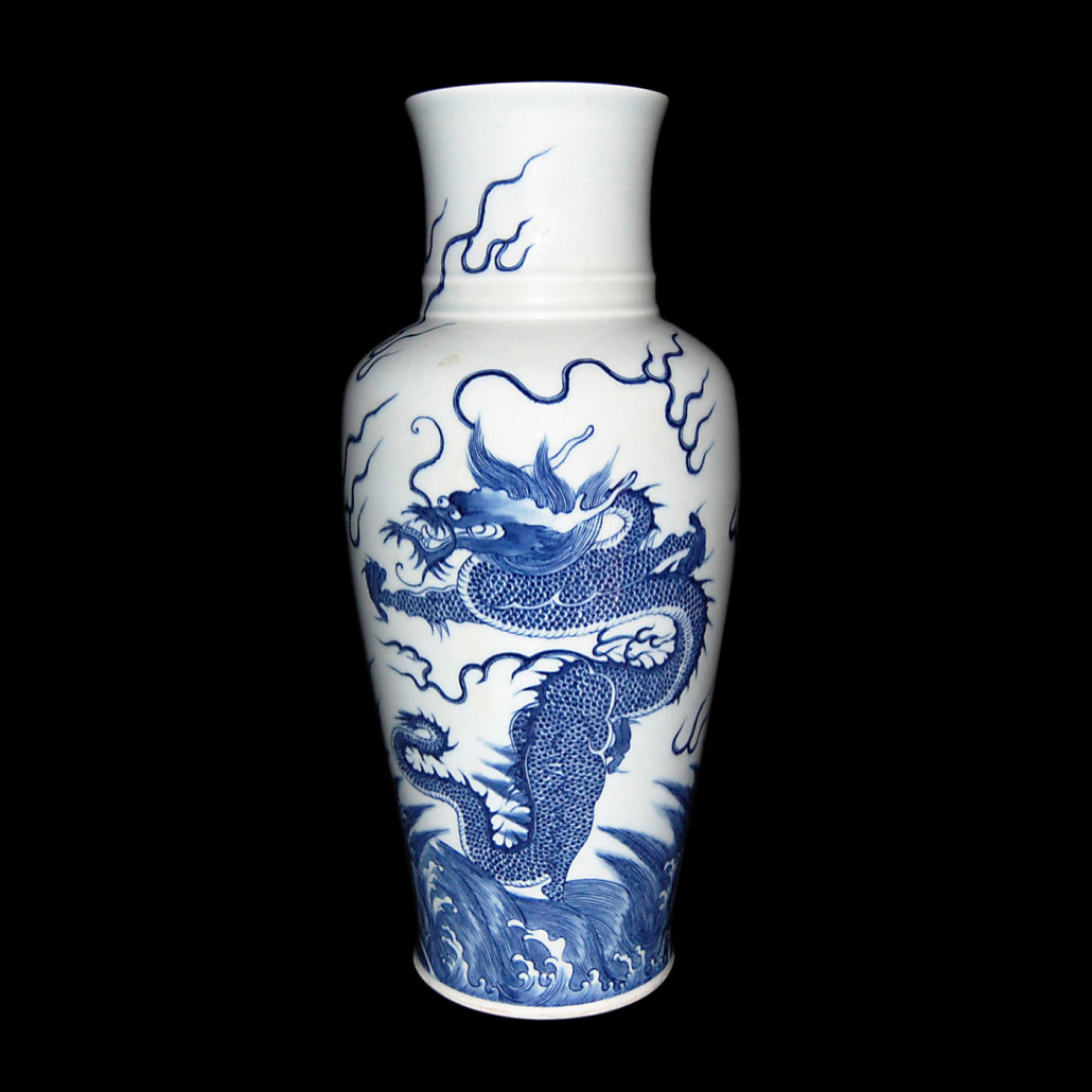 Blue and white dragon vase, 15 inches tall. Similar in design and workmanship to two masterpieces in China's Palace Museum in Beijing, and Shanghai Museum. Qing Dynasty, with Kangxi six-character mark and of the period. Estimate $50,000-$60,000