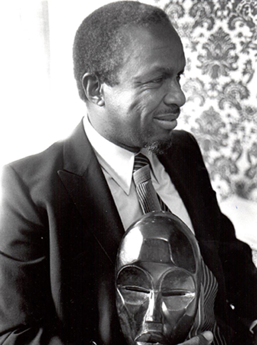Merton D. Simpson (1928-2013) with a prized African tribal art acquisition. Archival image provided by the Estate of Merton D. Simpson