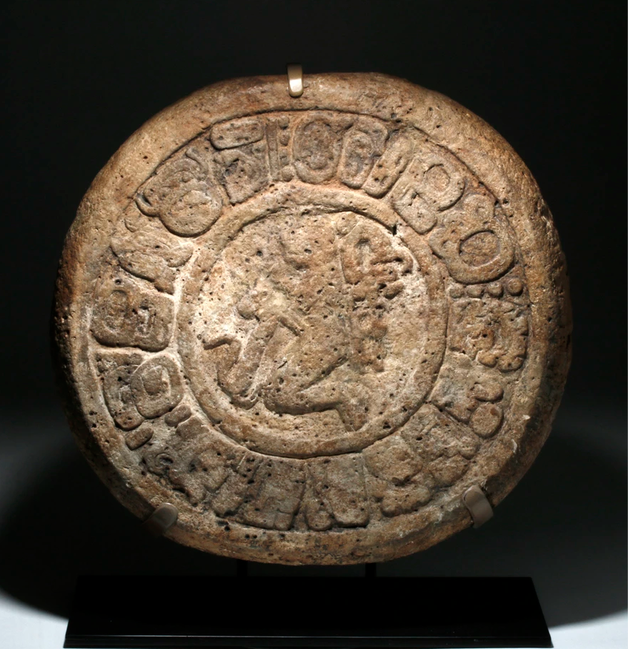 Important Pre-Columbian Mayan limestone ballcourt marker with approx. 16 carved glyphs, circa 400-500 CE, est. $80,000-$120,000