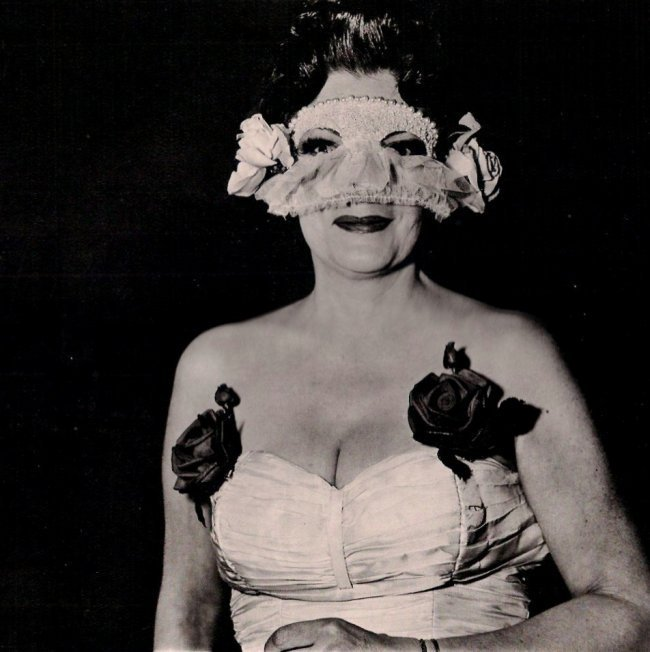 Diane Arbus, 'Lady at Masked Ball with Rose,' New York, 1967. Heliogravure with tissue guard, printed in 1979. Estimate: $100-$400. Jasper52 image