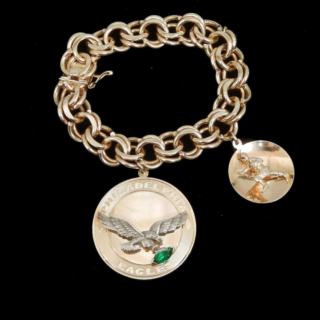 14K gold Philadelphia Eagles charm bracelet, weight 76.8 grams/49.3 dwt complete, est. $3,000-$4,000