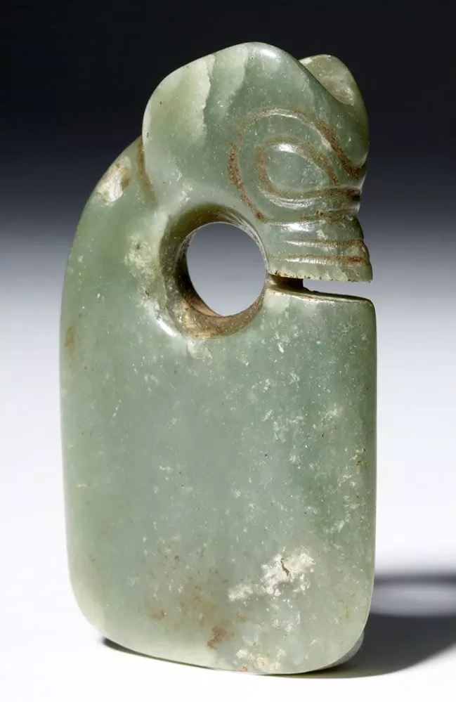 Chinese Hongshan Period green jade pendant, circa 3800-2700 BCE, est. $3,000-$6,000