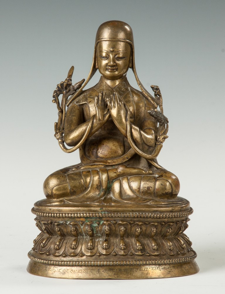 Gilt bronze figure of a Tibetan Sakya Lama, signed on the underside and inscribed along the base, 7 1/2 inches tall. Price realized: $42,550. Cottone Auctions image