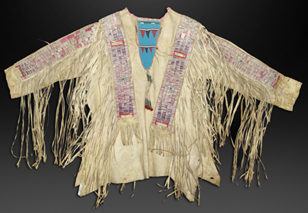 Northern Plains all-buckskin quilled war shirt with beautiful wide quilled sleeve and body strips and traditional geometrics. Estimate: $20,000-$40,000. Allard Auctions Inc. image