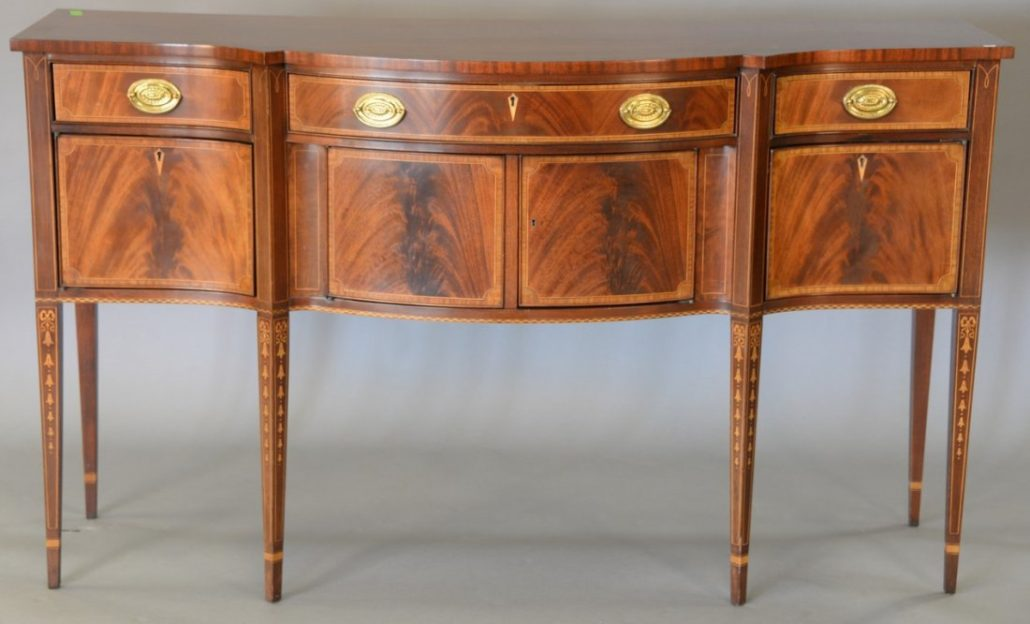 Custom mahogany Federal-style sideboard with line banding and bellflower inlays marked: 'made exclusively for Christmans Inc., Darien, CT.' Estimate: $400-$600. Nadeau's Auction Gallery image