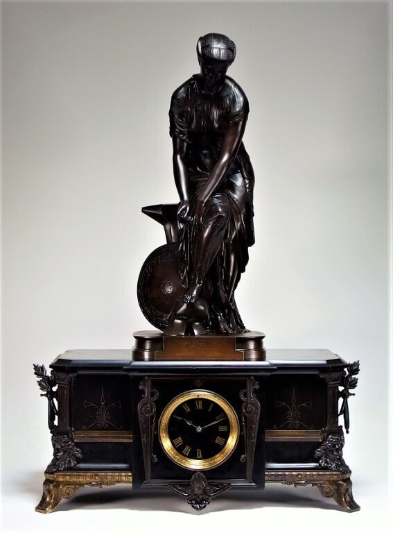 Neoclassical bronze figure of the Greek sea goddess Thetis by Pierre Eugene Emile Hebert, standing on a French Neoclassical black slate mantel clock (est. $1,000-$2,000). Bruneau & Co. Auctioneers image