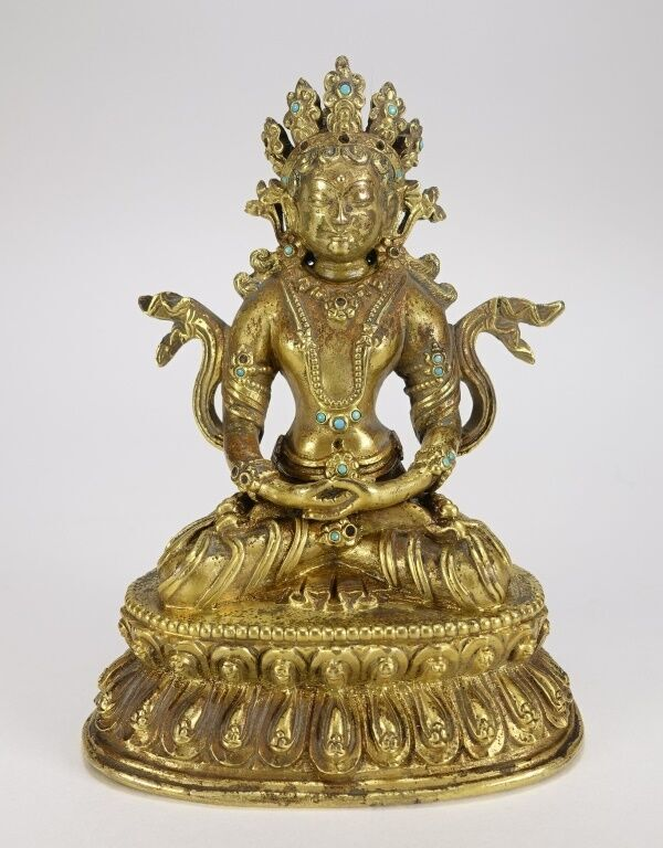 Nineteenth century Tibeto-Chinese gilt bronze figure of a seated White Tara, 5 inches tall (est. $2,000-$3,000). Bruneau & Co. Auctioneers image