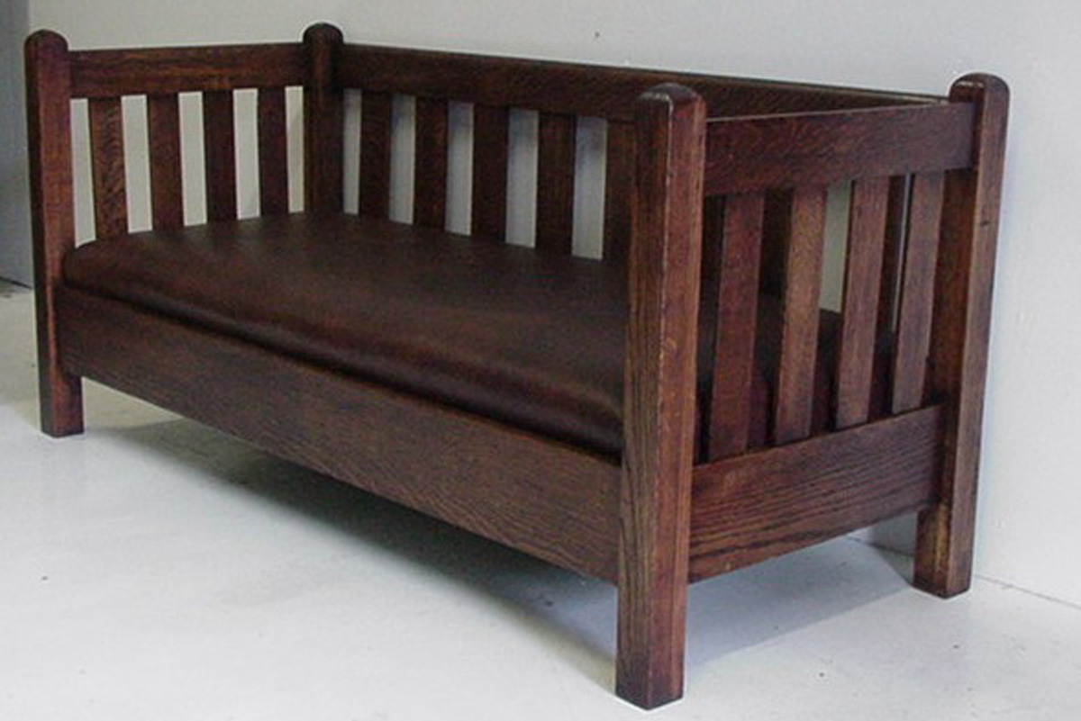 This Mission style settle shows the economy of decoration of the style, relying on the look of strength and clean lines for its attractive look.