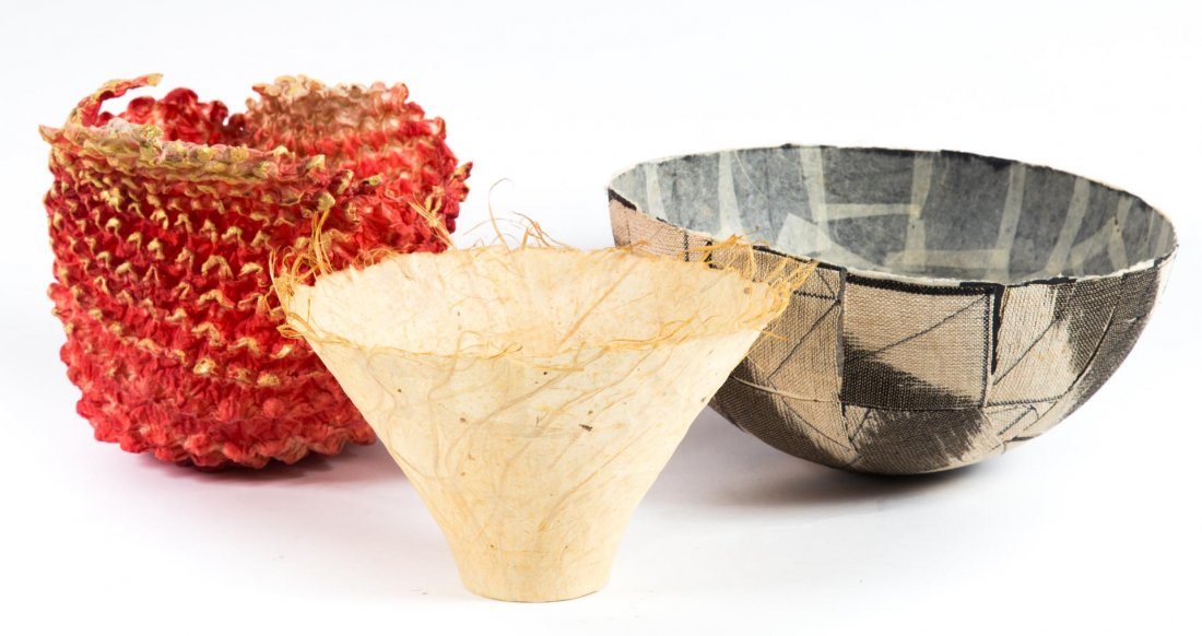 Kay Sekimachi, set of three bowl sculptures. Left: handmade paper, stamped on verso, 5 1/2 x 8 inches. Center: linen and handmade paper, stamped on verso, 6 x 10 inches. Right: 'Free Form Vessel,' red and white handmade paper with gilt highlights, stamped on verso, 7 x 10 inches. Price realized: $900. Alex Cooper image