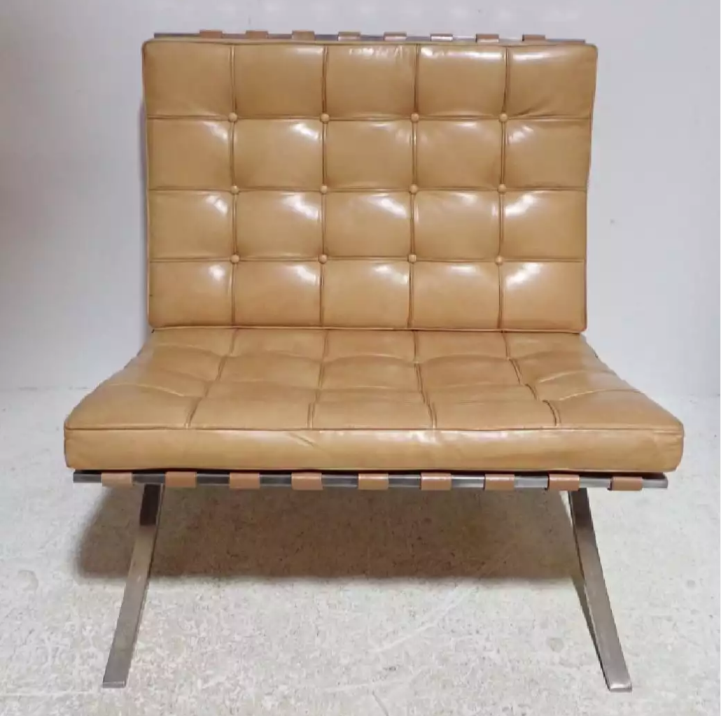 One of two matching Mies van der Rohe for Knoll Associates Barcelona chairs in tan leather. Entered as separate lots, each with a $500-$700 estimate