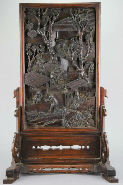 Chinese table screen, hardwood panel carved in relief, 22in.high x 14in. wide. Price realized: $12,000. Alderfer Auction image