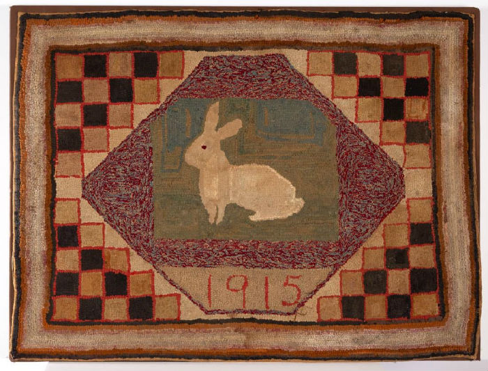 Hooked rug dated 1915, wool on burlap, 33in. x 42¾in. Price realized: $2,457. Jeffrey S. Evans & Associates image