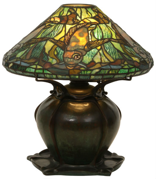 A rare Tiffany Studios leaded glass aquatic fish lamp ($80,00-$100,000) on a bronze pumpkin base has a shade surrounded by five swimming fish in gold mottled glass, 17½ inches tall with a 16-inch-diameter shade. Fontaine's image