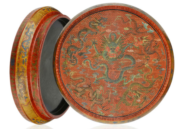 A dragon encrusted, gilt-incised and painted lacquer box portending longevity, 22 inches diameter, Qianlong six-character mark and of the period. Gianguan Auctions image