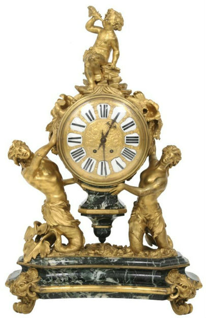 This French figural bronze and marble mantel clock stands 33 inches high by 22 inches wide. Fontaine's image