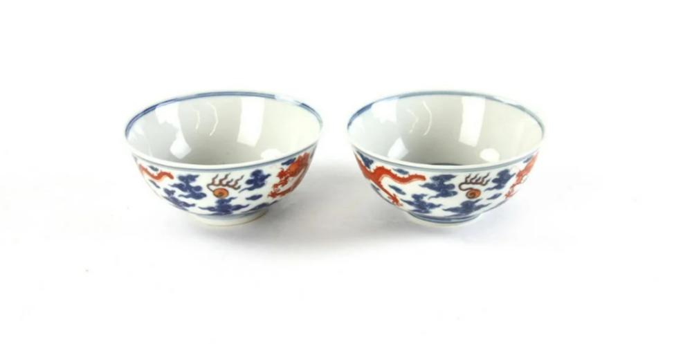 Pair of 18th-century Chinese enamel on porcelain bowls. Est. $8,000-$12,000