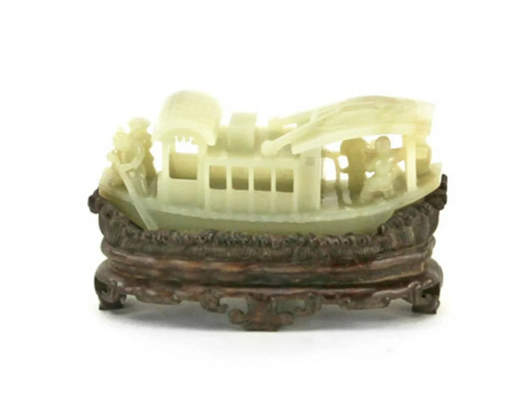 18th-century Chinese carved white jade boat on carved-wood, wave-shaped stand. Est. $5,000-$8,000
