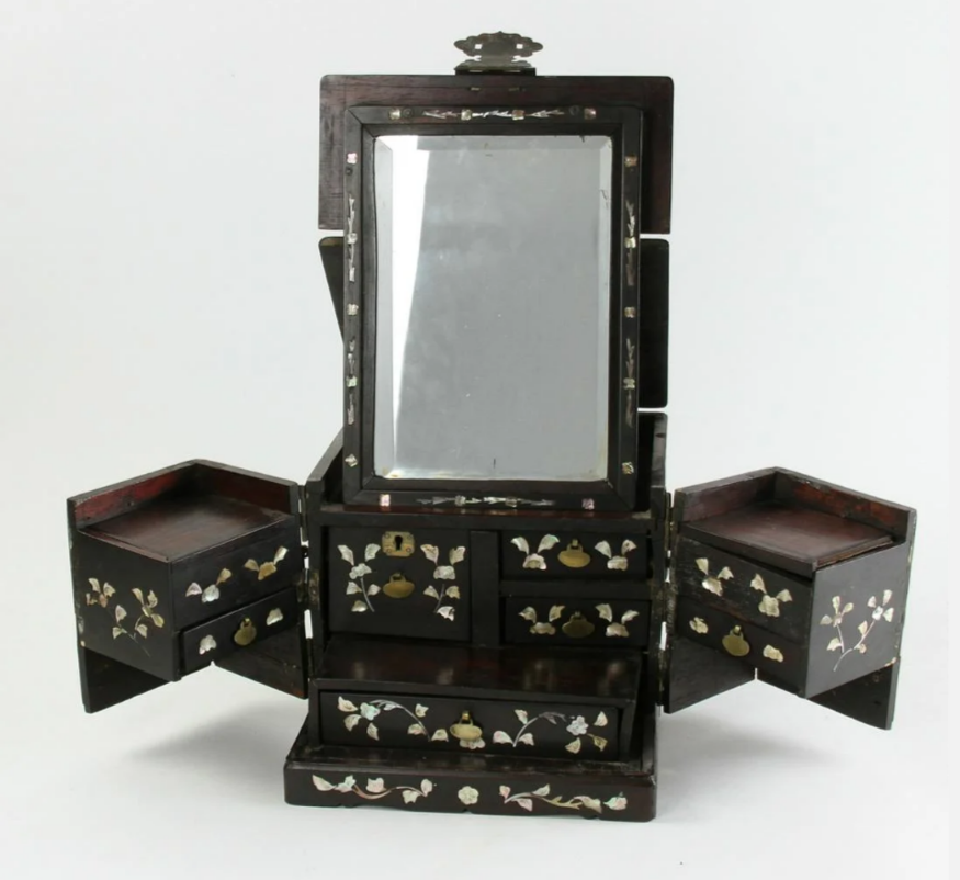 19th-century Japanese vanity box with mother-of-pearl inlay, floral elements and carved figures. Acquired by collector from Frank Caro Gallery, successor to C.T. Loo & Co. Est. $700-$1,000