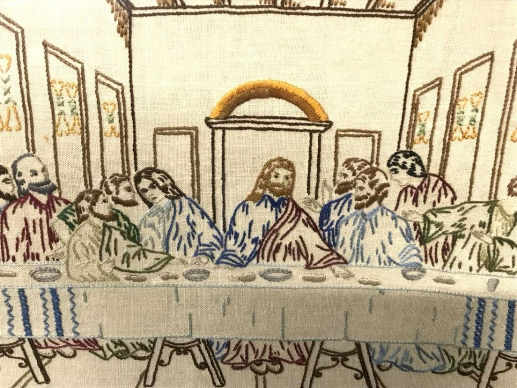 This unsigned pictorial sampler depicting The Last Supper, with Jesus and the Apostles embroidered in multicolored tones, measures 18 by 22¼ inches