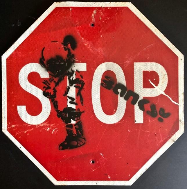 Banksy stop sign