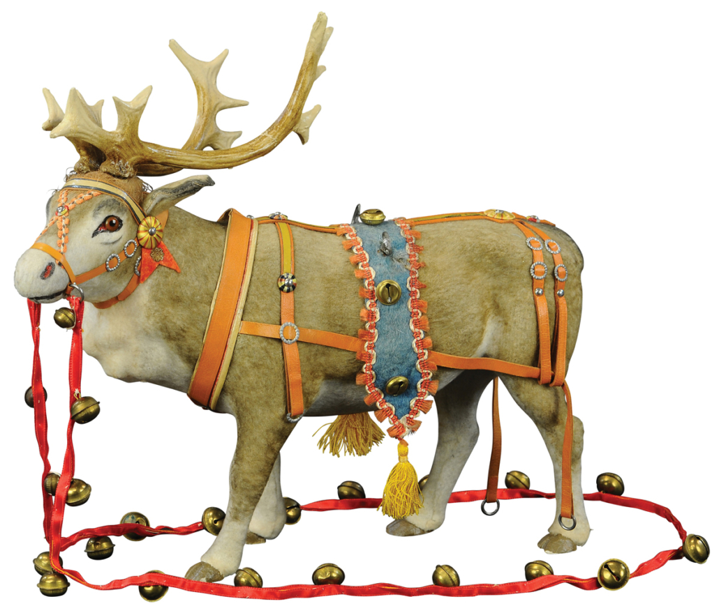 Magnificent 14-inch-long reindeer with brown glass eyes, elaborate harness and long ribbon of brass bells. Originally made for attachment to a Santa Claus sleigh. Retains original 'Made in Germany' tag. Estimate $2,000-$4,000