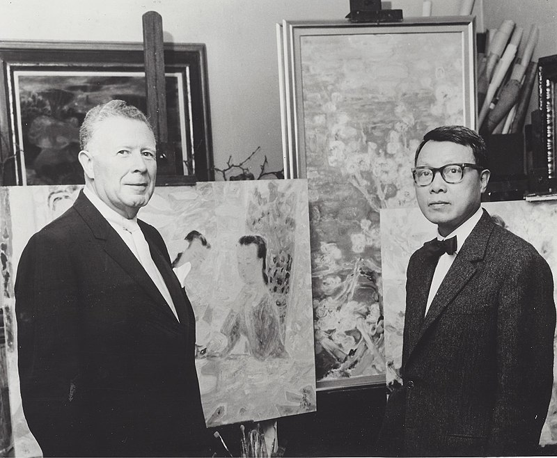 In a photo taken around 1964, the Vietnamese artist Lê Phổ (right) stands with Wally Findlay, whose Findlay Galleries in Chicago represented Lê Phổ's work for more than 50 years.