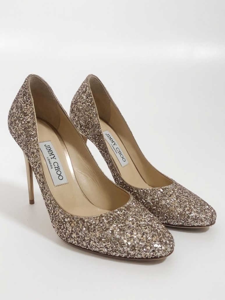 Jimmy Choo glitter pumps with silver metallic high heels. VG, barely worn condition. Size 39 (US 8½). Estimate $100-$200