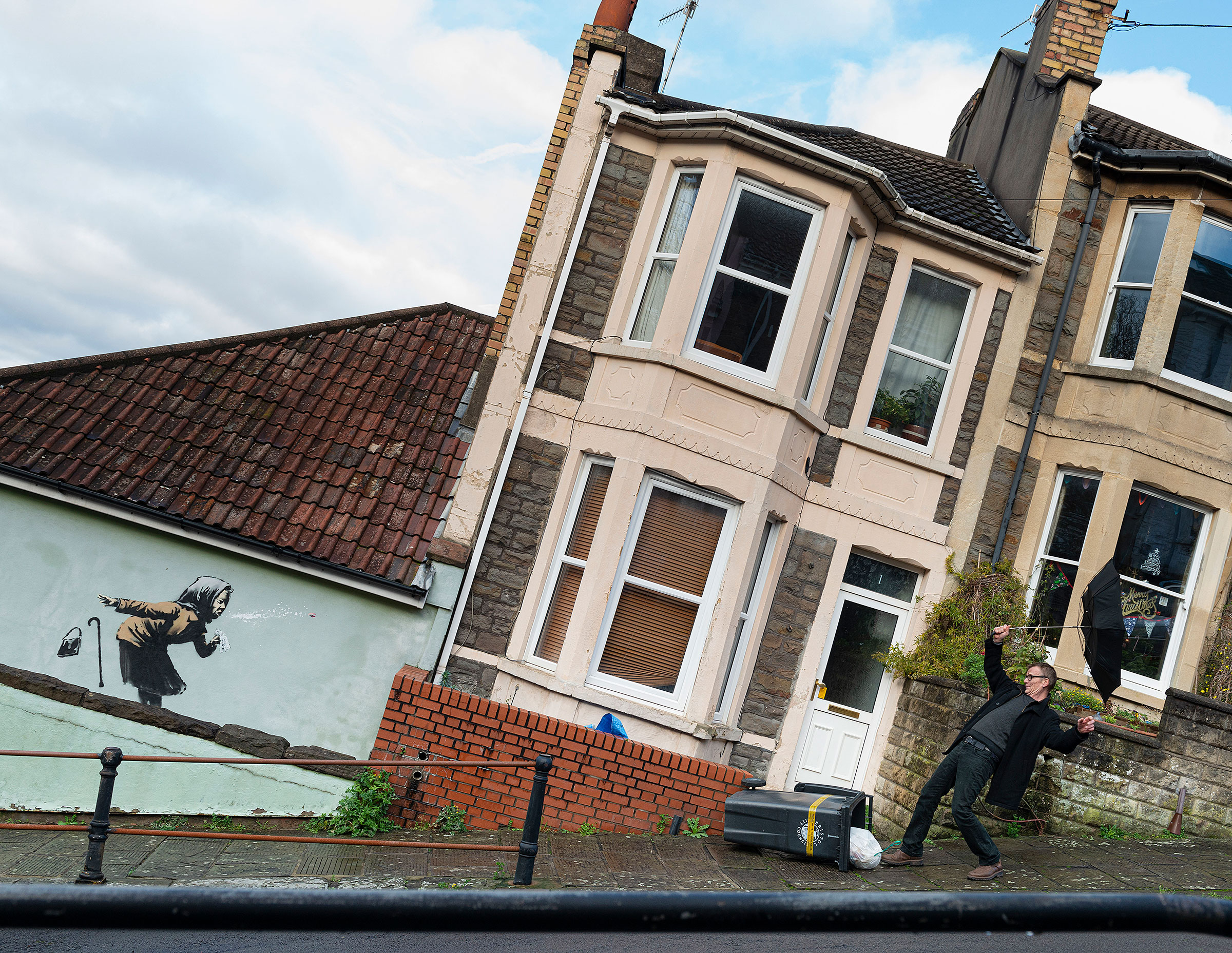 UK homeowner delays sale of home after Banksy mural appears