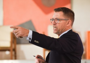 Auctioneer Rico Baca: he's strictly a 'modern' man