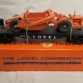 Lionel no. 6817 black flatcar and earth mover with Allis-Chalmers unit, $3,360. Image courtesy Weiss Auctions and Live Auctioneers.