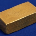 Important discovery gold ingot from the Vulture Gold Mine near Wickenburg, Arizona Territory, circa 1911-14, weighing 391.17 grams, 825 fine gold, with a report copy ($37,355). Image courtesy Holabird Western Americana Auctions and Live Auctioneers.