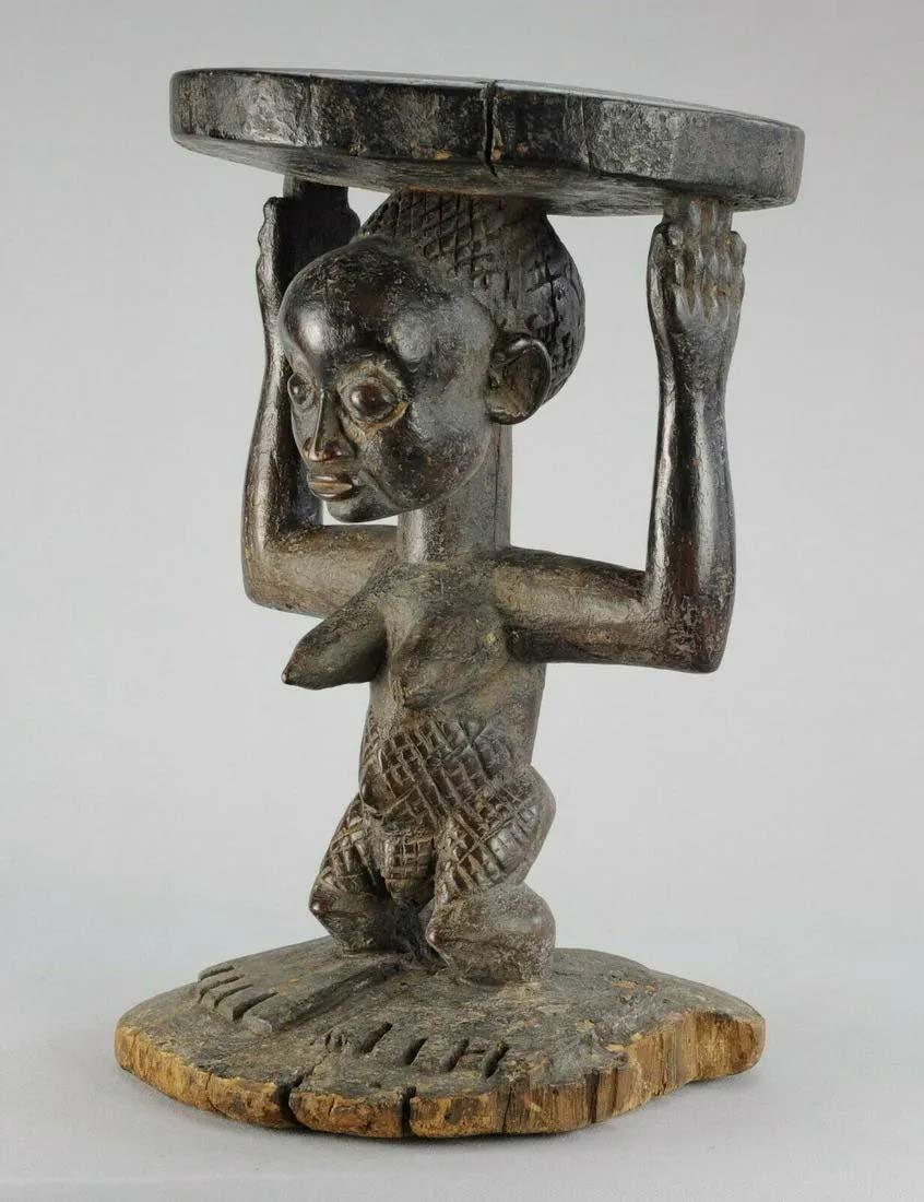 Luba Kanyok cariatid figural stool, Congo, estimate $2,500-$3,000. Image courtesy Jasper 52