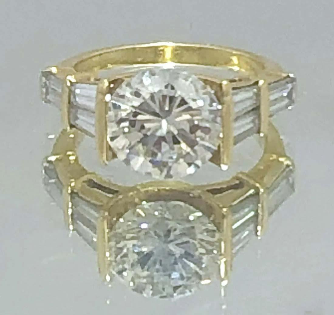 18K gold diamond ring with 3.10-carat round brilliant cut diamond, $30,000-$38,000.