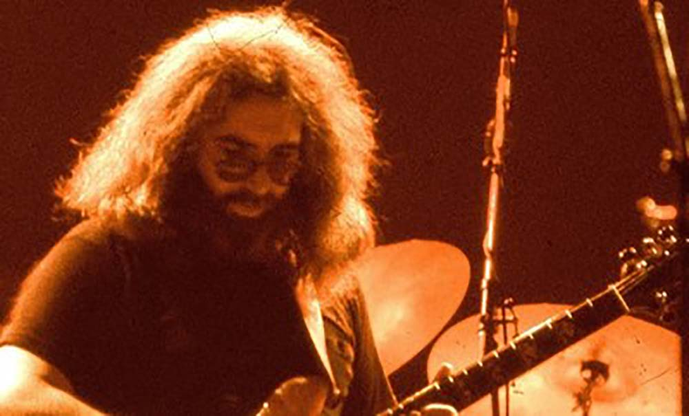 Jerry Garcia in concert. Image courtesy Jerry Garcia Music Arts, LLC