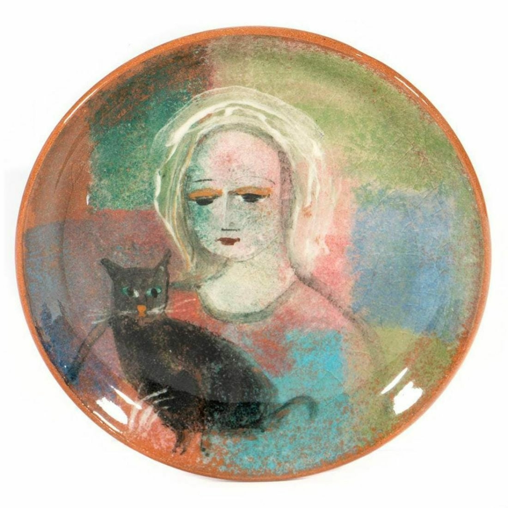 Mid-century Polia Pillin plate depicting a woman with a cat, estimated at $300-$500