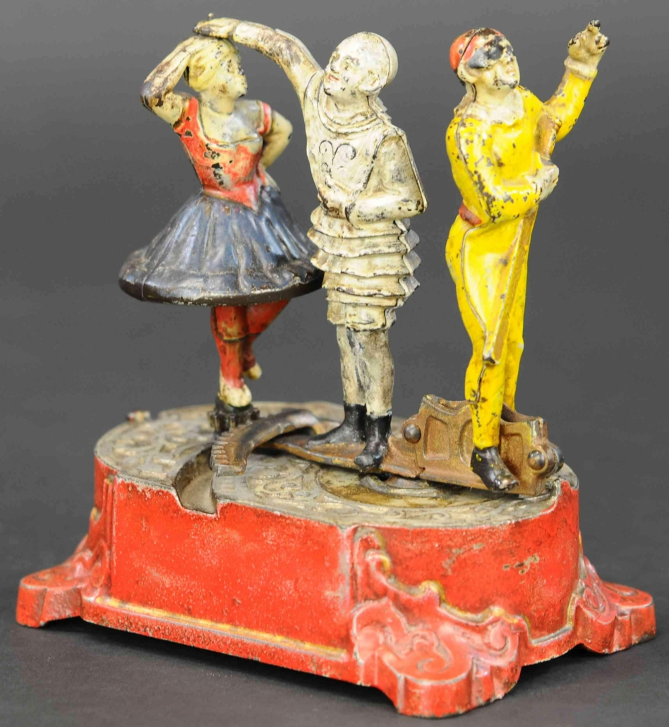 J&E Stevens Clown Harlequin and Columbine cast iron mechanical bank, which sold for $84,000