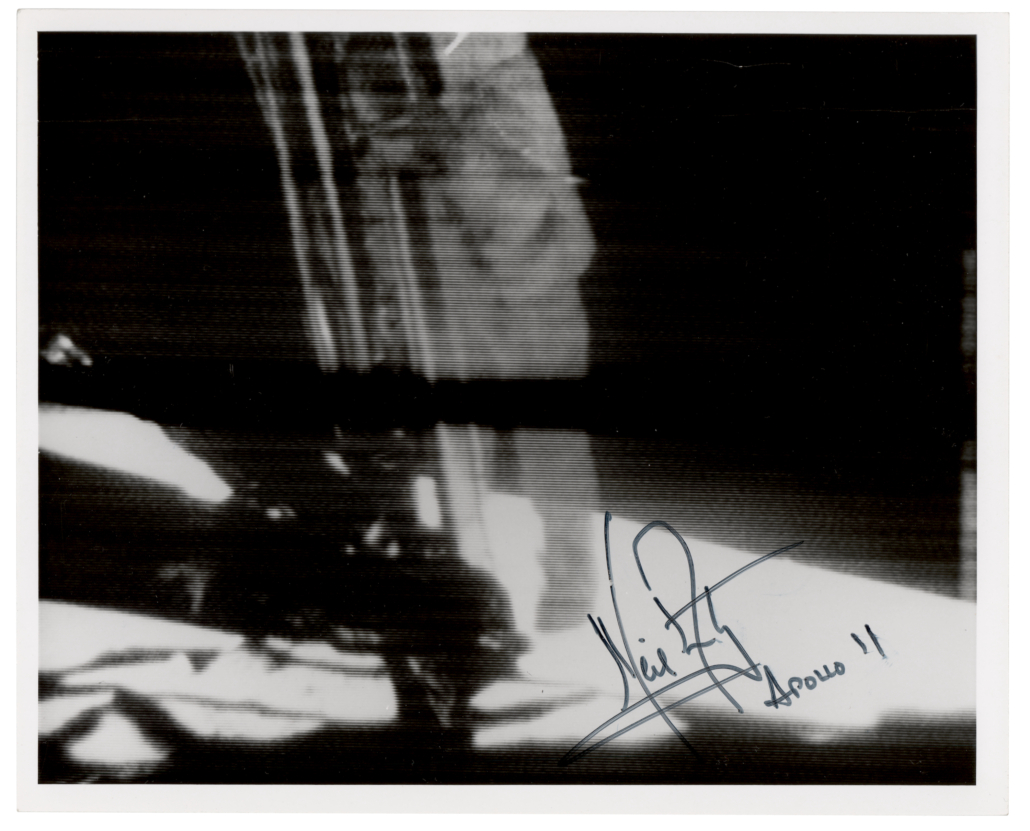 A Neil Armstrong-signed photo showing the astronaut about to set foot on the lunar surface sold for $91,451.