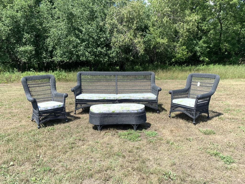 A four-piece Heywood-Wakefield wicker set, refurbished and painted charcoal grey, sold for $2,250 plus the buyer's premium in August 2020 at Blanchards Auction Service.