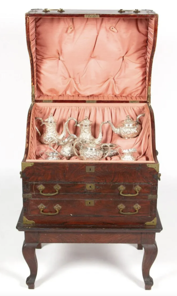 Sterling silver repousse service on original stand, which sold for $9,360