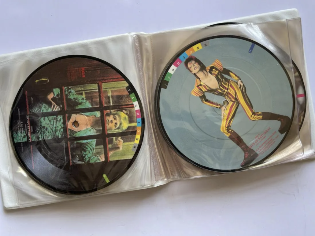 Two picture discs from the David Bowie 'Fashions' box set, estimated at $130-$200