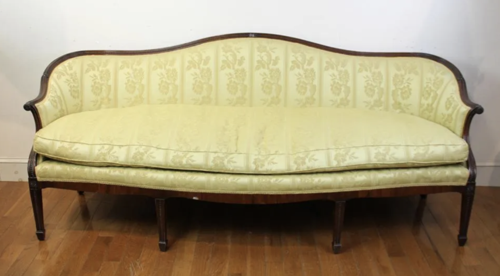 An English Regency style serpentine front sofa, estimated at $800-$1,200