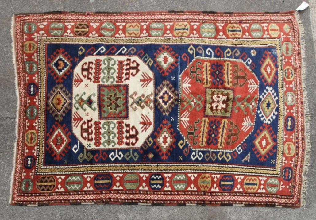 A late 19th century Caucasian Kazak rug, estimated at $3,000-$4,000
