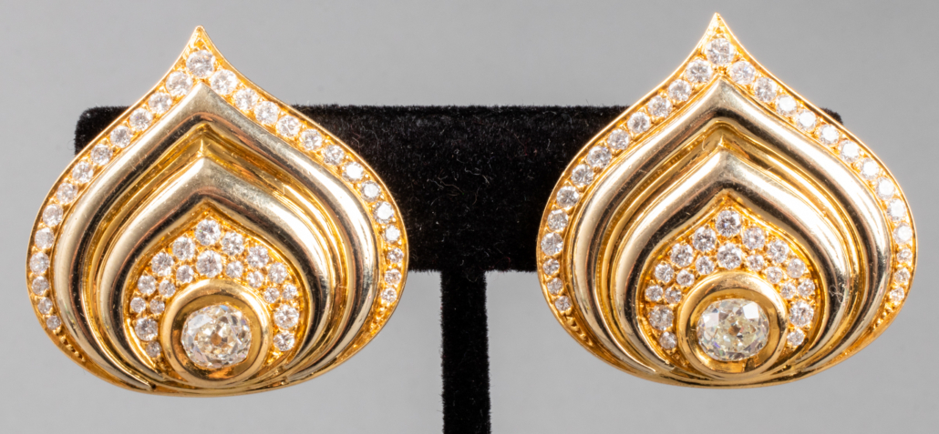 A pair of 1980s 18K yellow gold Paon heart-shaped clip earrings by French designer Marina B.