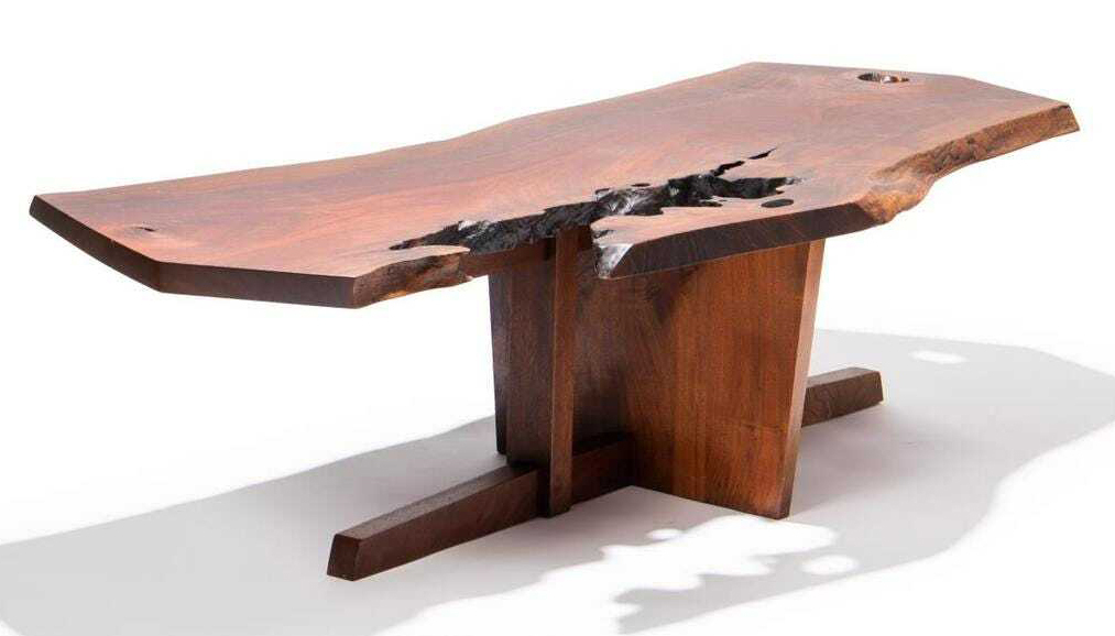 Nakashima 1966 walnut Minguren coffee table with rosewood butterfly, which sold for $74,400