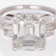 Emerald-cut diamond ring with flanking baguettes, estimated at $120,000-$180,000