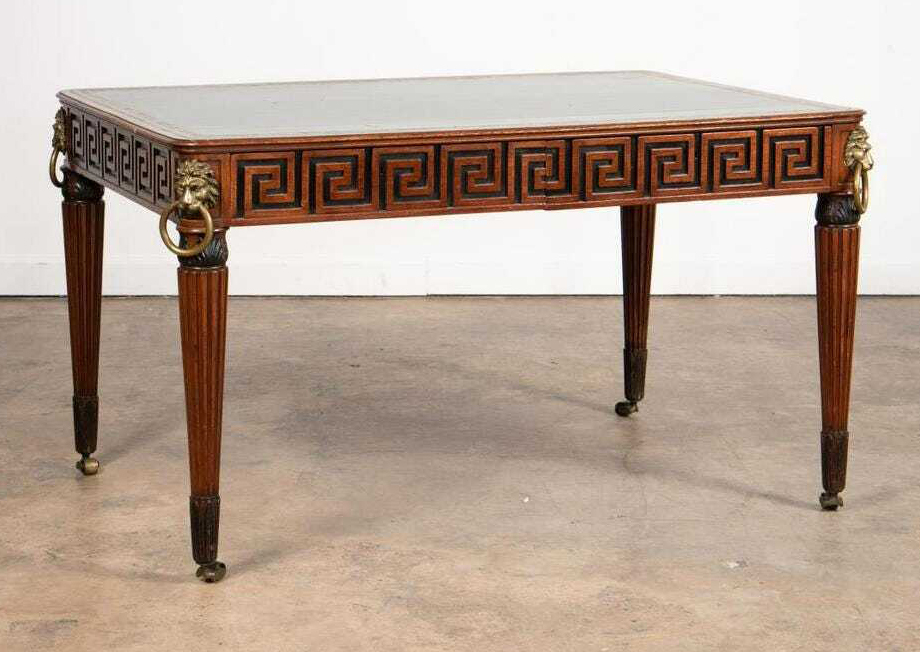 English part-ebonized mahogany library table in the Regency taste, which sold for $10,540